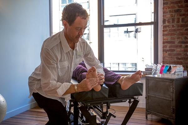 Chiropractor Dr. Ken Brassington, DC treats a patient at Physio Logic Brooklyn Heights.