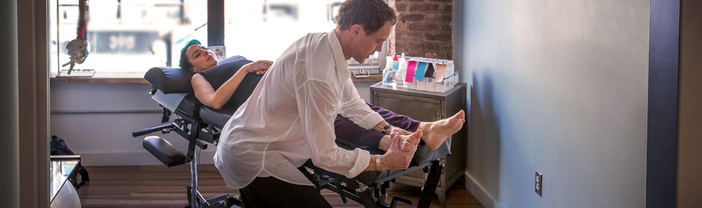 Dr. Ken Brassington treating patient with Active Release Technique at Physio Logic in Downtown Brooklyn