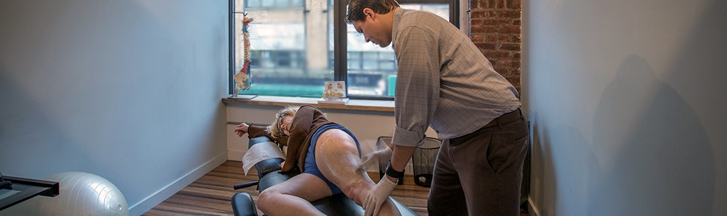 Chiropractor Dr. Stephen Szaro performing the Graston Technique on a patient.