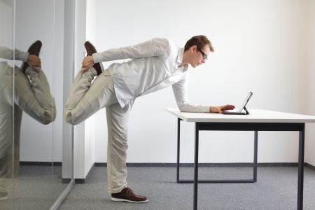 Stretch often while at work to prevent bad posture and injury