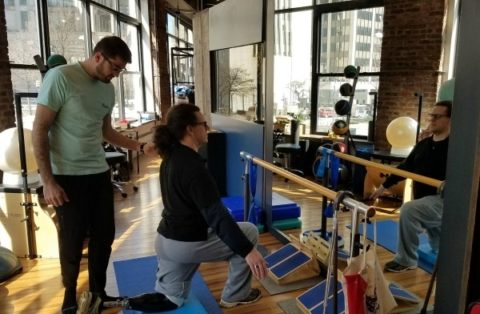 Gwen Le Pape working out with Klaus Dobra, DPT at Physio Logic