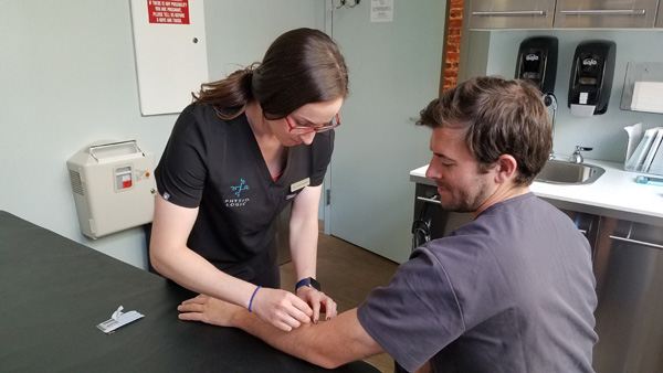 Dr. Allison Heffron treating patient with acupuncture 2