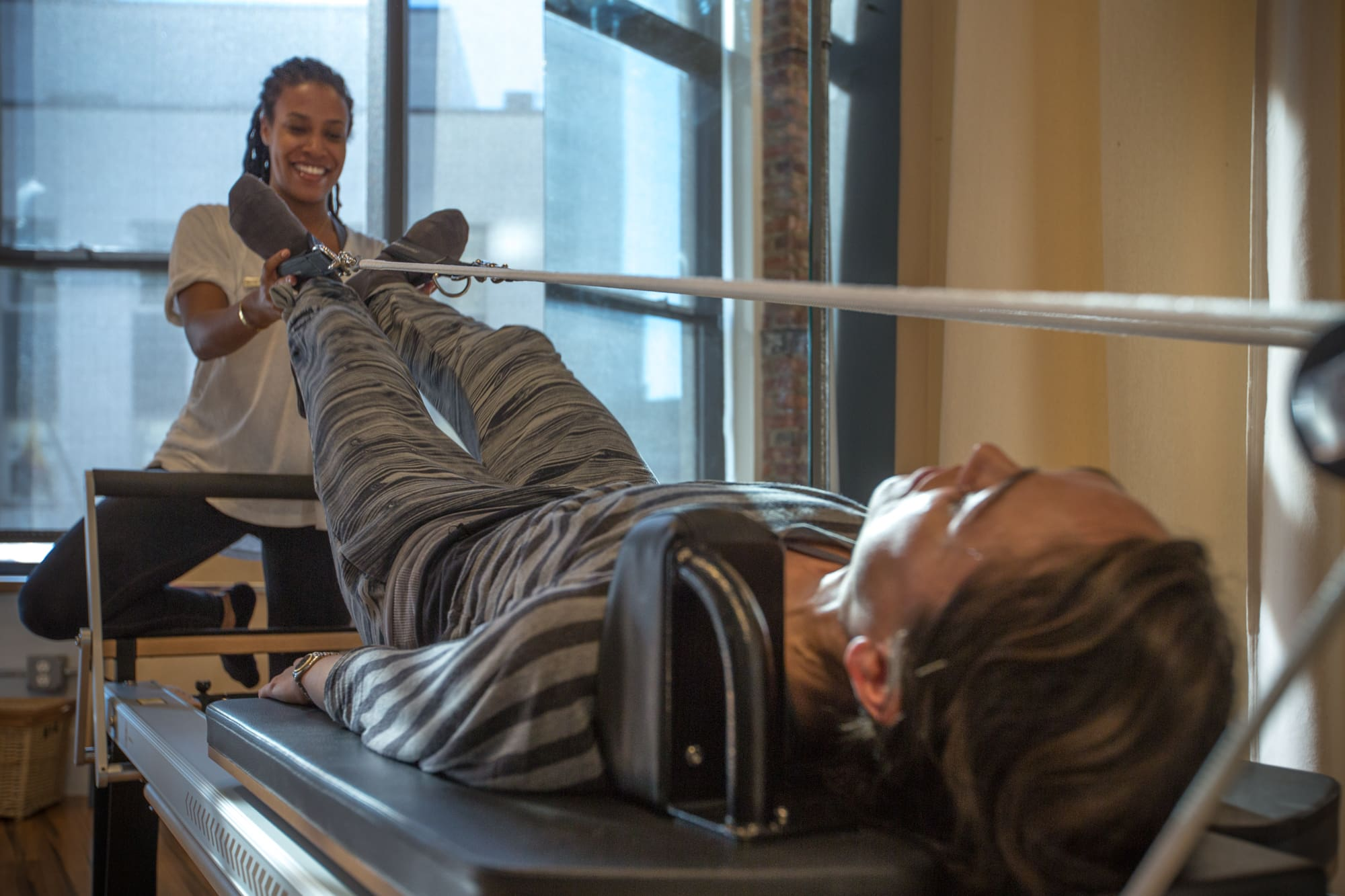 Physical Therapist Using Pilates Reformer | Physical Therapist Using Pilates-Based Physical Therapy | https://physiologicnyc.com/physical-therapy/